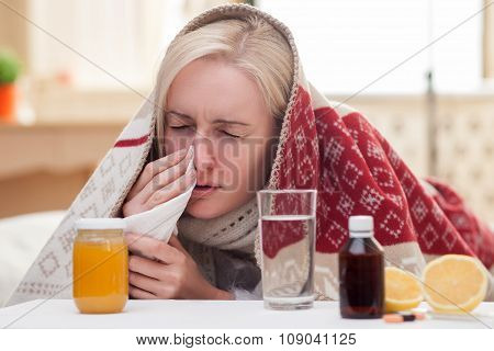 Ill young woman is suffering from flue