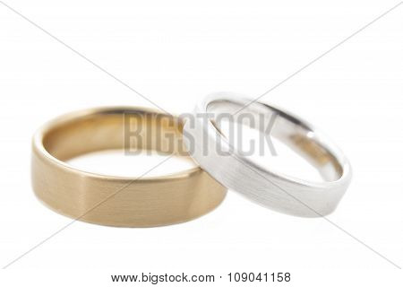 Two wedding rings isolated on white shallow DOF