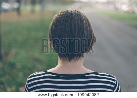 Lonely Casual Woman Walking Down The Street