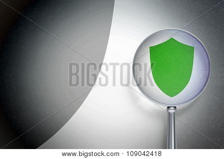 Security concept:  Shield with optical glass on digital background