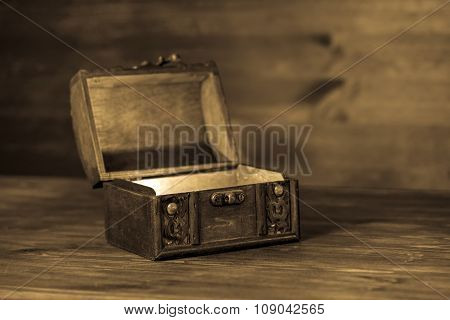 Beautiful Retro Chest  On Wooden Background With Place For Text, Closeup, Sepia Style