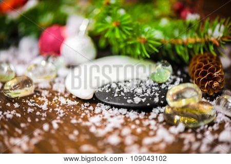 Still  Life Of Chinese New Year With Yin-yang Symbol, Cones, Red Ball, Fir Tree, Ice And Snow, Close