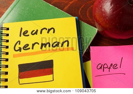 Notebook with  learn German sign. Education concept.