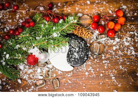 Concept Of Chinese New Year With Yin-yang Symbol, Apple, Cones, Red Ball, Fir Tree And Snow, Closeup