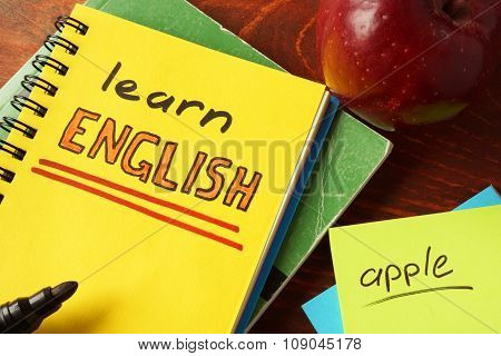 Notebook with learn English sign. Education concept.