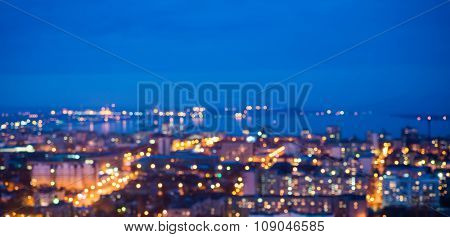 Defocused Abstract City Lights In The Twilight With River, Reflection And Horizon, Bokeh Background,