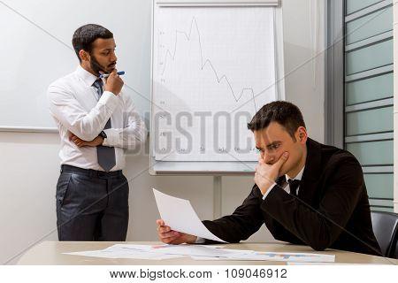 Businessmen solve a problem.