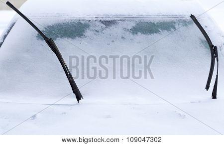 Windscreen Wipers On Snowy Car