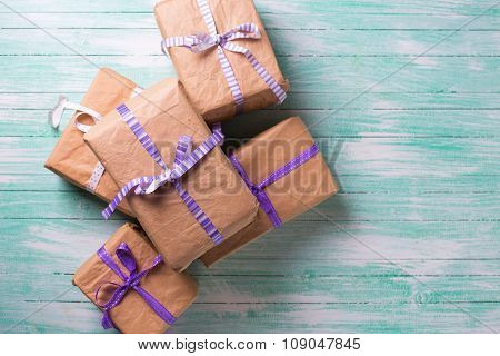 Wrapped Boxes With Presents On Turquoise Painted Wooden Planks.