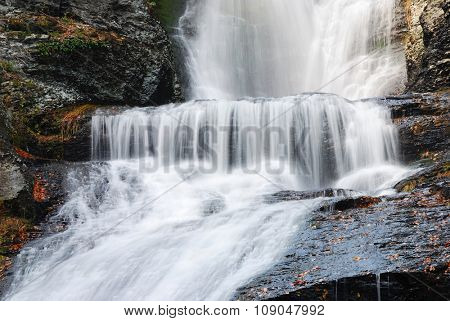 Waterfall in Autumn mountain with woods, foliage and rocks. From Digmans Fall of Pennsylvania