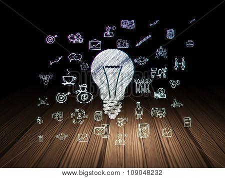 Business concept: Light Bulb in grunge dark room