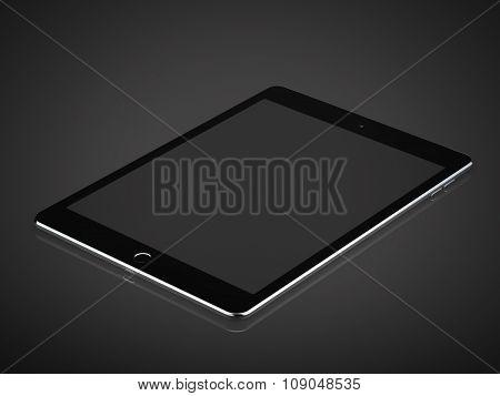 Tablet with blank screen in dark studio.