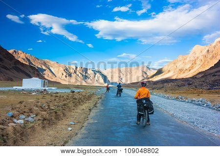 Two cyclist standing on mountains road. Himalayas, Jammu and Kashmir State, North India