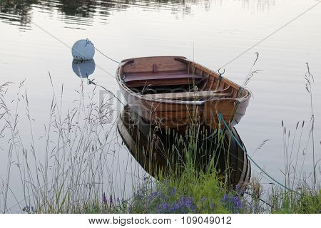 Rowboat In Calm Water In The Harbour