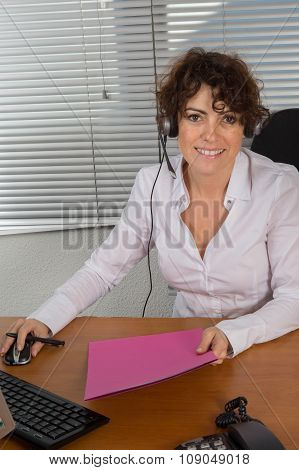 Female Customer Representative Using Computer