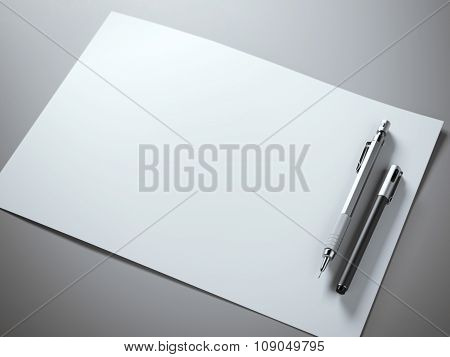 White paper sheet with metal pencil
