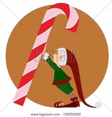 Christmas Elf and a big christmas candy