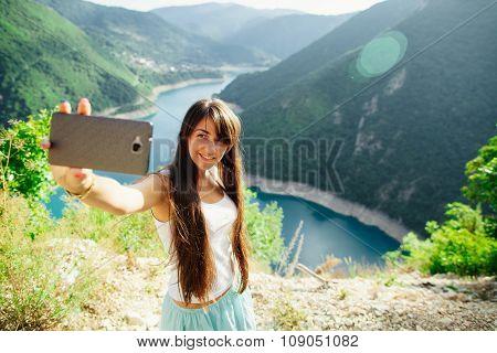 Happy Girl Taking Selfie Photo On Telephone