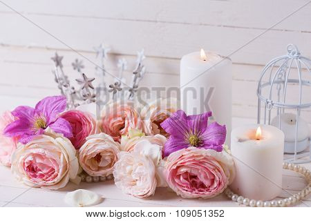 Pink Roses  And Violet Clematis Flowers , Candles  On White  Wooden Background.