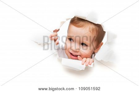 Funny  Child Baby Girl Peeping Through Hole In An Empty White  Paper