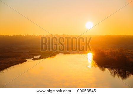 Beautiful Sunrise over Calm Lake, River in autumn. Sunset