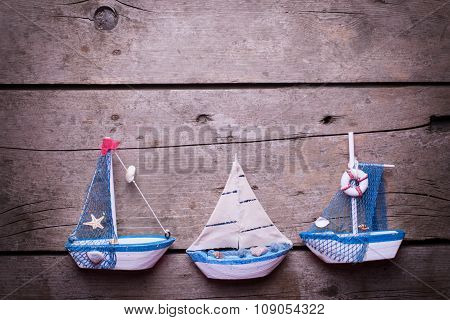 Decorative Sailing Boats On  Vintage Wooden Background.
