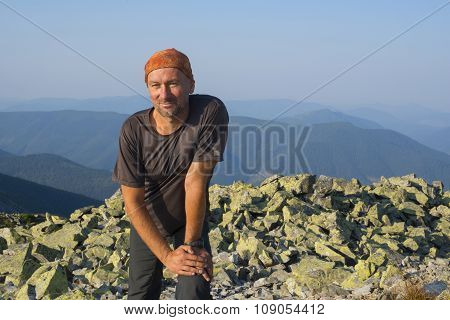 Hiker Resting Of A Rocky Top At A Wonderful Sunny Morning