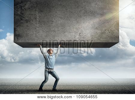 Guy lifting cement banner