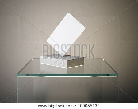 Stack of business cards on the glass podium.