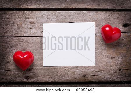 Red Hearts  And Empty Tag On Aged Wooden Background.