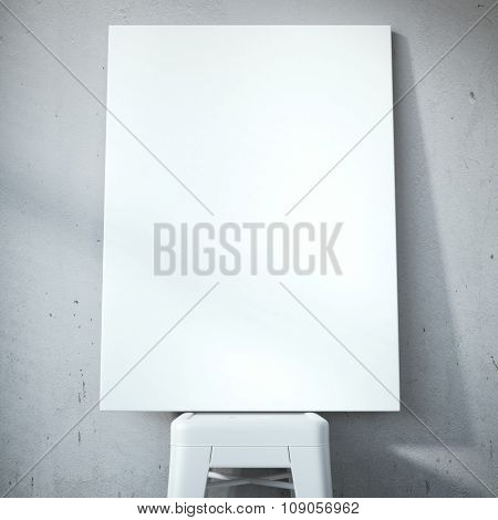 Blank white canvas on the chair near wall