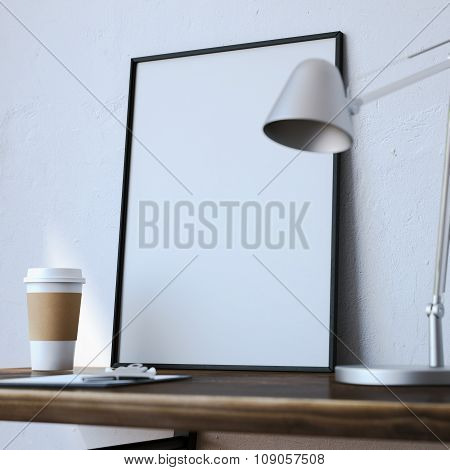 White blank frame on the table with lamp
