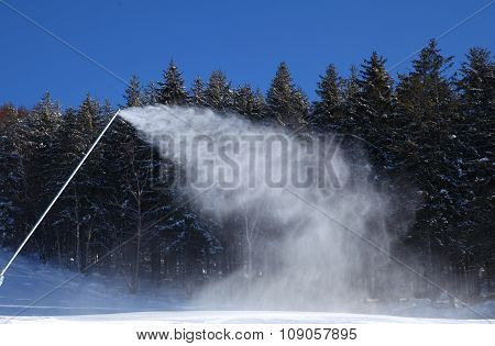Scenic View Of Piste With Snow Guns Operating