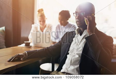 Black Business Man Using Cell Phone