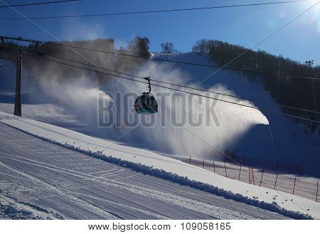 Ski Piste With Gondola Lift And Snow Guns Operating