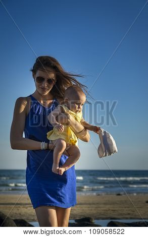 Sexy Mother Walks With Baby