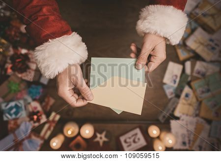 Santa Claus Opening A Christmas Letter