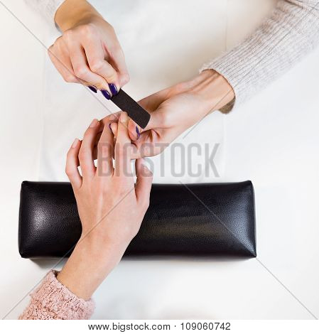 Image of hands polishing index finger