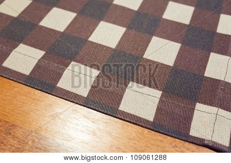 Tablecloth With Checker Pattern Over Wooden Table