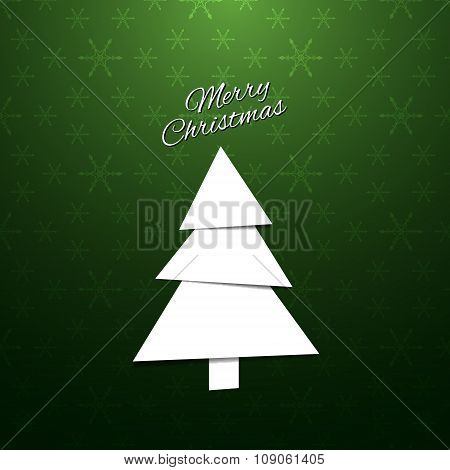 Paper Christmas Tree On A Green Background With Snowflakes