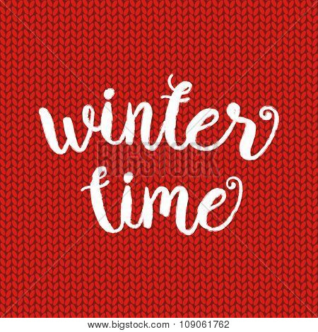 Winter time typographic poster. Vector hand drawn phrase.  Vector ink painted lettering on red wool knitted background. Banner with phrase for poster, tshirt, banner, card and other design projects.