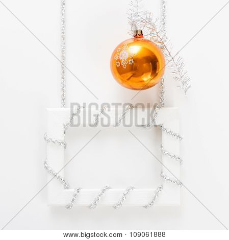 Greeting Card Template Made Of Horizontal White Frame With Silver Tinsel And Orange Ball