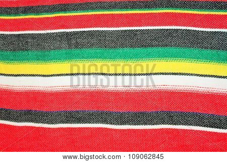 mexican traditional cinco de mayo rug poncho fiesta with stripes and bright colors