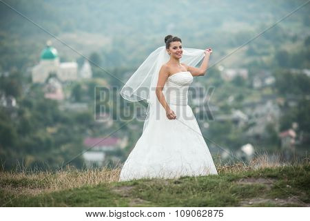 beautiful young bride poses for the camera