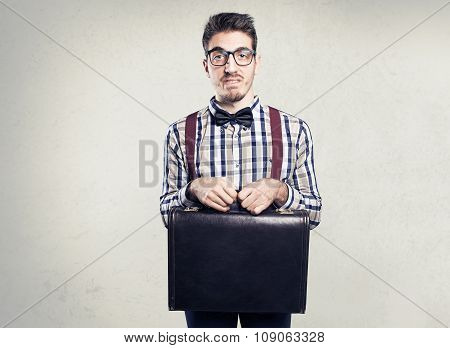 Young shy nerd with case in hands