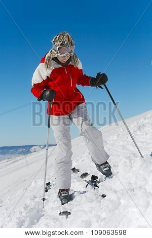 Female skier preparing to go