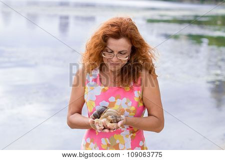 Red hair woman looking on snails