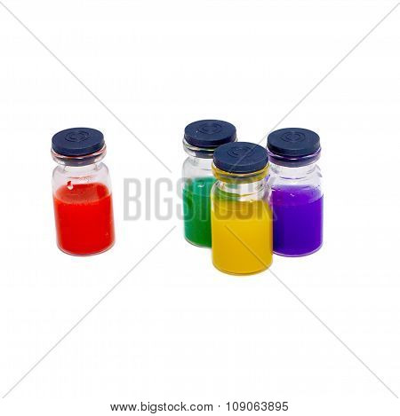 Four of pharmacy bottles with colored fluid