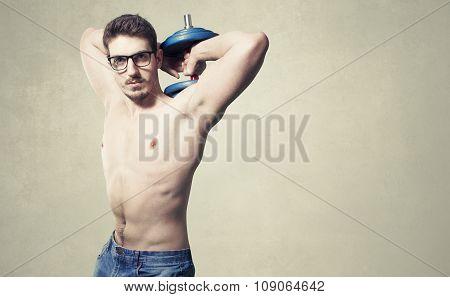 Nerd guy raising heavy weights