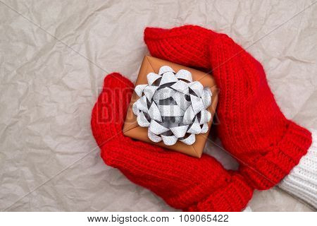 Woman In Mittens And Gift Box